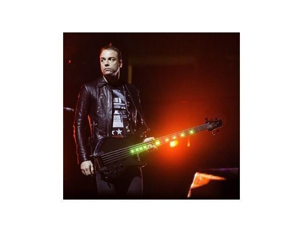 Chris Wolstenholme using Status Chris Wolstenholme Signature Bass 5-string