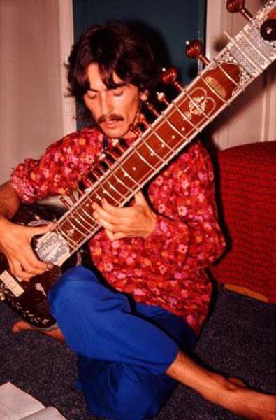 George Harrison using Sitar