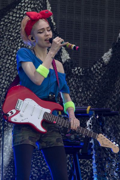 Grimes using Squier Stratocaster Electric Guitar