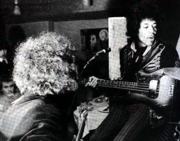 Jimi Hendrix using Fender Precision Bass