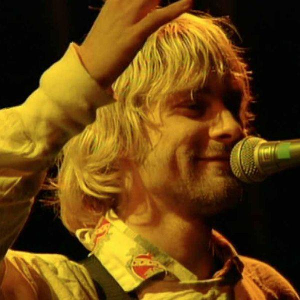 Kurt Cobain using Shure Beta 58A Vocal Microphone