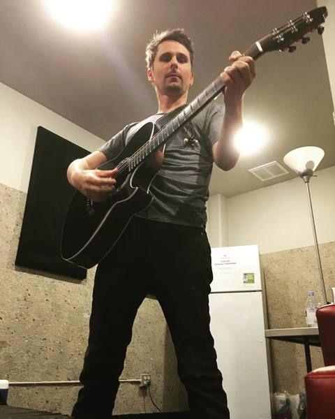 Matthew Bellamy using Manson Signature Acoustic Guitar