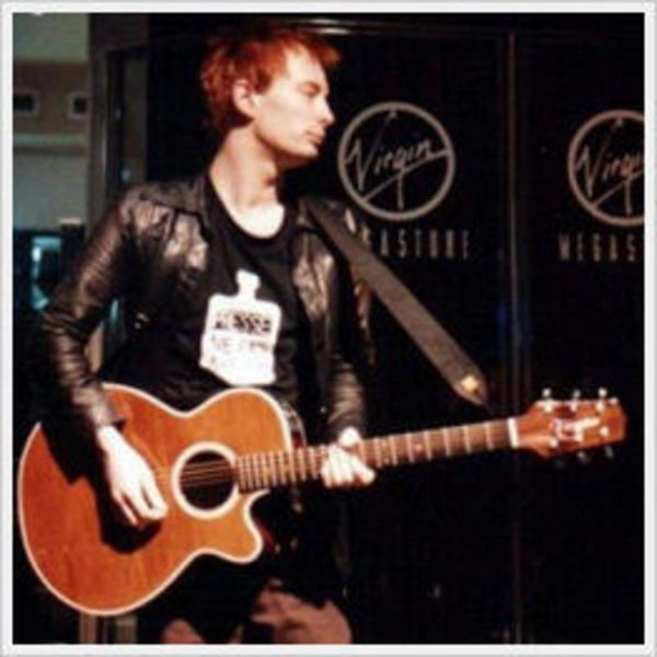 Thom Yorke using Takamine EF-261 SAN Acoustic Guitar